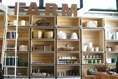 Similar for Green House floor shelves. Beautiful things shelved and mixed with pottery. NOD  farm shop