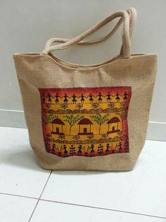 Warli painting on jute tote bag.