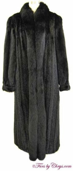 SOLD! Long Black Mink and Black Fox Coat BMF767; Excellent Condition; Size range: 10 - 14. This is a stunning genuine dyed black mink fur coat with dyed black fox fur trim, in a nice, long length. It features a black fox tuxedo collar, banded bracelet cuffs and lightly padded shoulders. When the event calls for elegance and sophistication, this gorgeous black mink coat will fit the bill. fursbychrys.com