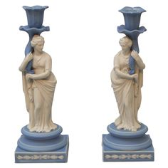 Wedgwood Candlesticks England  Circa 1800 Rare pair of Wedgwood blue and white jasper figural   candlesticks,. each with a classical woman holding a cornucopia, upper case mark
