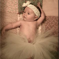 My wee lassie  I made this tutu from a pinterest tutorial & tweaked it a bit. The flower headband is satin rolled fabric with petal, feather & pearl accents. Photograph by the great @RickyBennett & @ElizabethBennett. Quilt by Becky Butler & Liz Setzer.