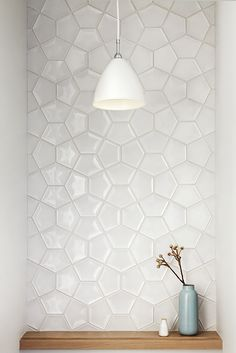 Simple pendant light, tile, and vase have a powerful impact.