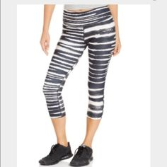 Nike Capris worn once Nike tight fit capris in black & white print, size small (4-6) Nike Pants Capris