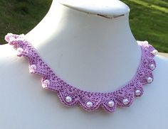 Pearl In The Shell Crochet Necklace.     This is a very elegant and beautiful necklace. You will enjoy it!!!