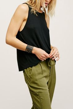 Lightweight ribbed tank in a shapeless fit with a low scoop back. This effortless and easy style looks great with anything. Pair with braletteor wear bare.   Sleek Easy Tank  by Free People. Clothing - Tops - Tees & Tanks Cleveland, Ohio