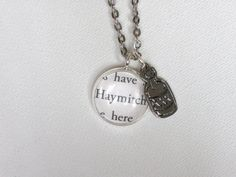 This Haymitch pendant is hilariously brilliant. I want it. $16.