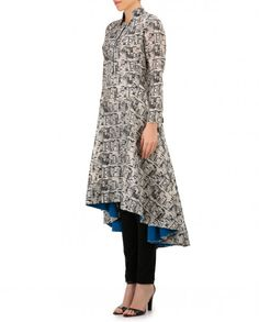 Ivory book printed chanderi kurta comprising an asymmetrical kurta with a band collar with contrast blue front button placket. Full sleeves. Wash Care : Dry clean onlyChuridar leggings are for styling purpose only