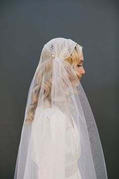 long curls down with a beaded juliet cap veil of tulle