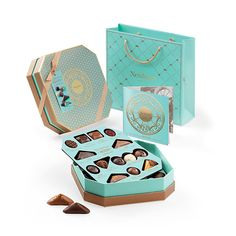 Discover the timeless Belgian chocolate masterpieces created by the Neuhaus family in this beautiful chocolate gift box. A gourmet chocolate gift that is sure to delight.