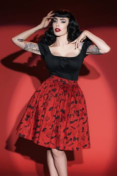 Deadly Dames Darling Dames Skirt in Fetish. Looking for the perfect skirt to finish off your look and make your day even better? This delightful design is similar in look to our famed Pinup Couture Jenny Skirt thanks to its carefully gathered skirt, fitted waistband, and flirty flair, but this Deadly Dames by Micheline Pitt style offers a shorter hemline and hidden side pockets. Finished off with a back zip and available here in Micheline Pitt's kinky Fetish Print!