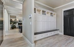 Built-in lockers with bench and shoe storage bins keep this mudroom clean and tidy. Clark and Co. Homes Spring 2014 Parade Home