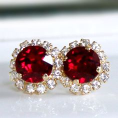 Brilliant Ruby Red Swarovski Crystals Framed with Halo Crystals on Gold Post Earrings by CJRoseBoutique on Etsy https://www.etsy.com/listing/218545514/brilliant-ruby-red-swarovski-crystals