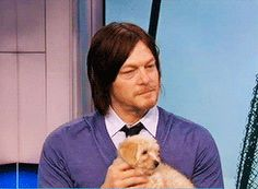 And also when he cuddled puppies, because he's an equal opportunity lover: | 24 Reminders That Norman Reedus Has Always Been Ridiculously Sexy