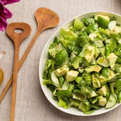 This all-green salad is studded with creamy avocado, crunchy cucumbers, and asparagus, and punctuated by tons of fresh dill and basil. The varied shades of green look like spring in a bowl.