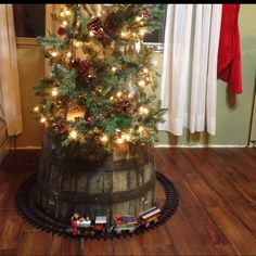 I love this idea of the barrel at the bottom of the tree! Child proofing and beautiful! Whiskey Country Christmas | Christmas