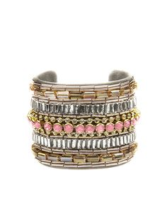 #Bracciale rigido decorato con strass e pietre color pesca