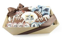 The perfect super bowl party gift basket! Our game day gift basket includes 4 football sugar cookies decorated with milk and white chocolate, One jumbo chocolate covered sugar cookie, 8 small logo rice krispies, and 15 chocolate logo Oreo. Each one decorated with your favorite teams logo or have a mixed basket including both teams! Football favors, super bowl favors, sport gift baskets, fathers day, superbowl 50, carolina panthers, denver broncos, game day sweets,  super bowl desserts