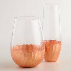 Perfect for enjoying your favorite wine or Champagne, our affordable stemless glasses feature a vibrant copper faceted bottom.