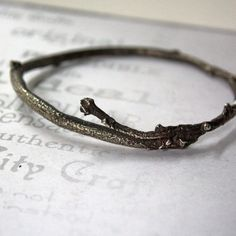 silver cast branch bangle