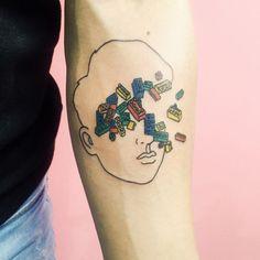 tattooideasdb:  Lego Faced Boy Tat by Kim Michey