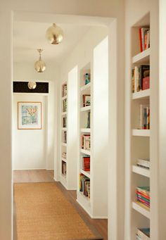 Love the bookcases along the hall way
