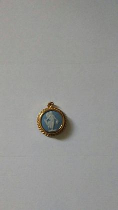 Authentic cameo ware pendant by Wedgewood of England. Fine