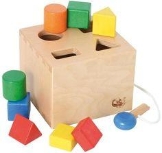 Wunderschöne Sortierbox mit Schlüssel und acht farbigen Holz Bausteinen.