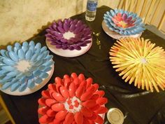 plastic spoon garden flowers how to, crafts, repurposing upcycling I think I'll add some of those half glass marbles from the dollar store to the centers.