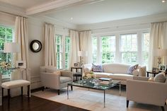 Vivian: McGill Design Group - Chic living room with white sofas and chairs,coffered ceiling,  ...