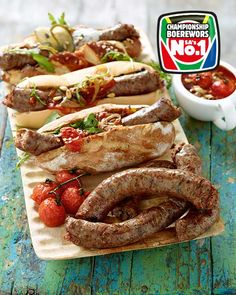 Gourmet Boerewors Rolls - This tried and tested family favourite gets an extreme makeover # Comfort Food Braai Recipes, Appetizer Recipes, Healthy Recipes, South African Dishes, South African Recipes, Hot Dogs, State Fair Food, Sausage Recipes, Food Inspiration
