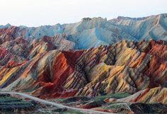 """The colorful Danxia mountains of China: """"Danxia refers to a """"type of petrographic geomorphology"""" found in China. What that means is you get these mountains that look as though they were decorated with crayons by a five-year-old channelling Dalí."""""""