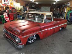64-66 Chevy C10 pickup slammed on the ground with a patina two two paint job and satin clear.