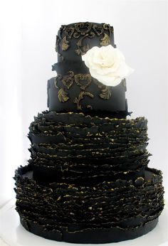 Black Ruffle Cake!! This would be cool for like a masquerade Halloween party