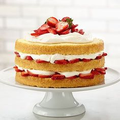 This decadent three-layer strawberry shortcake dessert is just waiting for fresh summer strawberries. Baking Hack: coating the pans with sugar creates a crunchy edge on this tender pound cake. Strawberry Shortcake Recipes, Strawberry Recipes, Yummy Treats, Sweet Treats, Yummy Food, Köstliche Desserts, Dessert Recipes, Savoury Cake, Let Them Eat Cake