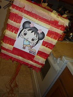 Pull String Pinata - DIY Tutorial We could put pictures of her on it or decorate it with farm theme stuff.