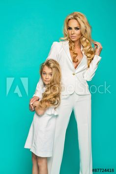 Fashion woman with preatty little girl posing