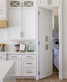 A hidden door to the #pantry masked by cabinetry doors. Now that just screams CUSTOM! . Design Inspiration: @theolsenhomedesign Photo: @lindsayjsalazar #pantrydesign #kitchendesign #hiddenpantrydoor #hiddendoor #whitekitchen #whitekitchendesign Tall Kitchen Pantry Cabinet, Kitchen Cupboard Designs, Pantry Room, Pantry Design, Cabinet Design, Kitchen Layout, Kitchen Ideas, Kitchen Design, Hidden Cabinet