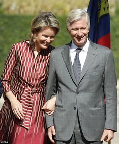 Queen Mathilde, 44, lovingly holds on to King Phillippe's, 57, arm during a speech ...
