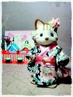 I want to make a custom kimono for my Calico Critters.  This one is lovely.
