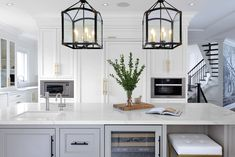Oversized kitchen island and traditional pendants. Kitchen design by Amanda Forrest Design Toronto.