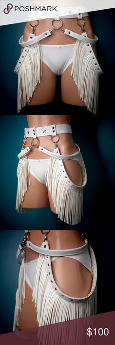 White Fringe Fashion Harness Belt I make these harnesses from scratch in my home studio. It made with high-quality vegan leather and can be worn to a festival, show, photoshoot. You name it. Straps are detachable and can be placed any way you like it.   Please read carefully to determine your correct size. Digits represent adjustable width of the belt band in Inches.  If you don't see your size. Please contact me, I can make the custom version.  S***	25, 26, 27  M	***28, 29, 30  L	***31, 32…