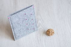 Handmade felt sleeve for the Kobo tablets and e-readers. It will fit the e-book/ tablet perfectly and protect it from dust and scratches. The e-reader sits in the sleeve just tight enough as to protect it from slipping out accidentally.  The sleeve is made of light grey coloured 2 mm thick