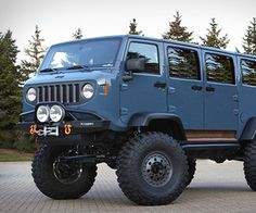 Impressive vehicle by Jeep, the Mighty FC is a retro rock crawler defies any preconceived notions you may have regarding scale and balance...