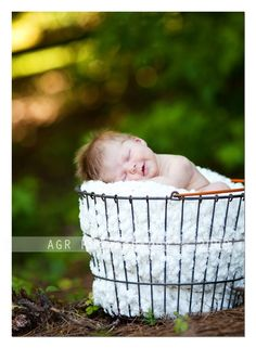 Outdoor Session  ISO 250  f/2.2  1/640  135mm 2.0    Same basket, different baby, different setting. I like to find spots where the background has some distance from the subject. This set up makes for beautiful bokeh. Especially if you have a little back light like I do here    Newborn Photography: How to Use Light When Shooting Newborns