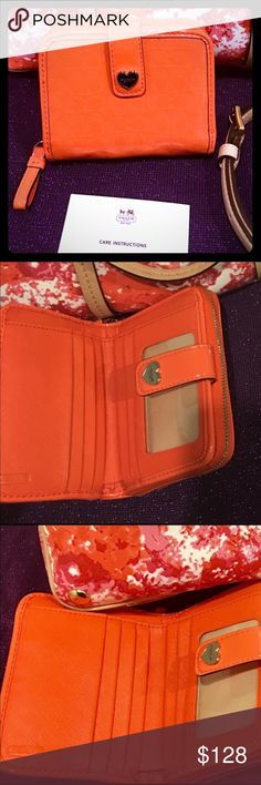 """🦋HP🦋 Coach RARE! LIQUID PATENT LEATHER  WALLET 🦋HP🦋COACH! RARE! LIQUID PATENT LEATHER Orange WALLET Authentic Coach Perforated Embossed Liquid Gloss Med Zip Around Wallet F51678 Silver Coach logo on front Buckle closure ID window, 6 Credit card slots, 1 Large bill slot, Zip coin pocket 4.75"""" W x 3.75"""" H x 1"""" D *** this listing is for wallet only** Coach Bags Wallets"""