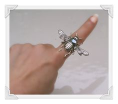 Another of my friends work, she is mad about bees!!    Silver Bee Ring - Extra Wide Iridescent Glitter Wings - Aurora Borealis Vintage Glass. $45.00, via Etsy.    https://www.etsy.com/listing/108483503/silver-bee-ring-extra-wide-iridescent?ref=sr_gallery_14_search_query=mentalembellisher_view_type=gallery_ship_to=US_ref=auto4_search_type=all_facet=mentalembellisher