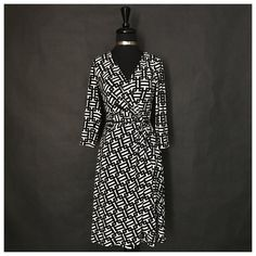 "This is a gorgeous Maggy London brand wrap dress. The dress is black and white, has a v-neck line, long sleeves, and knee length. Made of 95% polyester and 5% spandex. Very cute! Makes a great cocktail or evening dress,    The dress is a size 2 with the following measurements:    Length: 40.5""    Bust Range: 36"" - 47"" (stretchy material)    Waist Range: 24"" - 30""    This item ships immediately to US addresses. 📦 Also available for local try on and pick up in Sacramento, CA. ✨ 