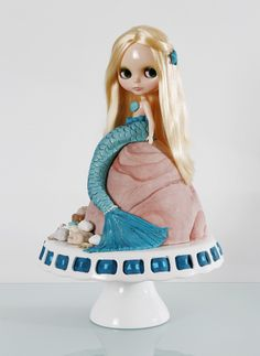Mikaela really liked the tail on this one and even the rock idea with may e waves splashing up but not this doll, maybe a Barbie :) looks like the legs r n the cake and the tail is actually part of the cake