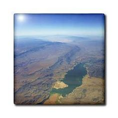"""Aerial View Lake Meade - 12 Inch Ceramic Tile by Florene. $22.99. Dimensions: 12"""" H x 12"""" W x 1/4"""" D. Clean with mild detergent. Image applied to the top surface. Construction grade. Floor installation not recommended.. High gloss finish. Aerial View Lake Meade Tile is great for a backsplash, countertop or as an accent. This commercial quality construction grade tile has a high gloss finish. The image is applied to the top surface and can be cleaned with a mild ..."""