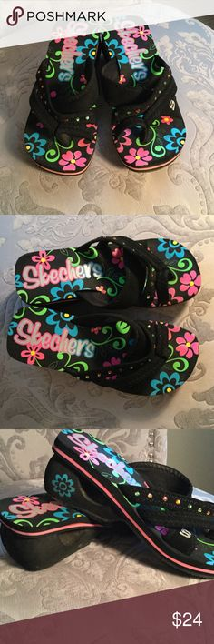 Cute Skechers wedge sandals. Really cute Skechers sandals with beads. Black with colorful floral design. Lightly worn soles. Good condition. Skechers Shoes Sandals